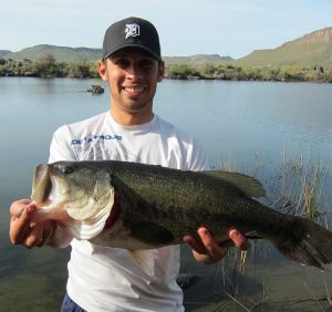Jordan Rodriguez holding a largemouth bass