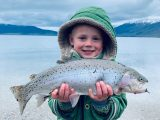 Young boy holding a large cutthroat trout at Henry's Lake in Idaho