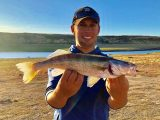 Jordan Rodriguez shows off a walleye caught at Salmon Falls Creek Reservoir.