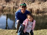 Jordan Rodriguez and his daughter Quinn show off a rainbow trout caught in Hagerman