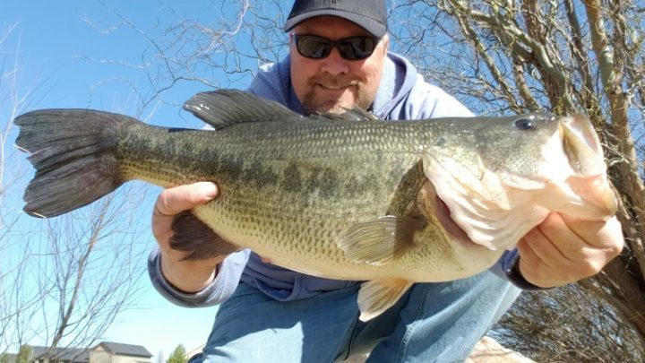 Angler Jon Urban takes a selfie with a huge largemouth bass