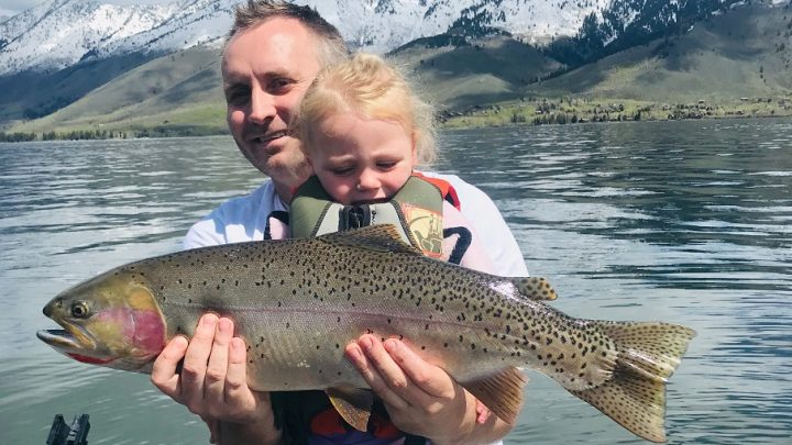 Skyler Shippen and his young daughter Joslyn show off a large cutthroat trout caught at Henry's Lake in eastern Idaho.