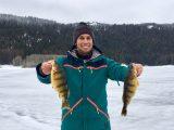 Jordan Rodriguez shows off two jumbo perch caught at Lake Cascade.