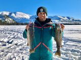 Jordan Rodriguez with two rainbow trout caught through the ice at Warm Lake