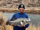 Jordan Rodriguez shows off a replica mount of a 24-inch largemouth bass.