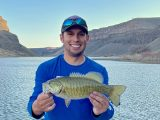Jordan Rodriguez holds a 16-inch smallmouth bass caught on the Snake River.