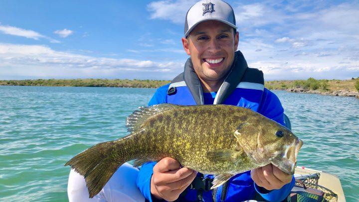 Jordan Rodriguez holds a large smallmouth bass