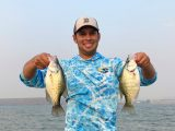 Jordan Rodriguez shows off two large crappies he caught at C.J. Strike Reservoir